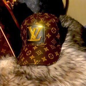 Louis Vuitton Ball cap worn once.  Very nice!!